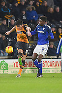 Hull City defender Harry Maguire (12) kick towards gola getting ball away from Sammy Ameobi of Cardiff City during the Sky Bet Championship match between Hull City and Cardiff City at the KC Stadium, Kingston upon Hull, England on 13 January 2016. Photo by Ian Lyall.