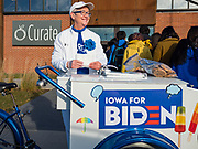 23 NOVEMBER 2019 - DES MOINES, IOWA: Deb Madison-Levi hands out cookies and ice cream to people in line for a Joe Biden campaign event. Vice President Biden announced that Tom Vilsack, the former Democratic governor of Iowa, endorsed him. Biden and Vilsack appeared with their wives at an event in Des Moines. Iowa hosts the first presidential selection event of the 2020 election cycle. The Iowa caucuses are on February 3, 2020.                   PHOTO BY JACK KURTZ