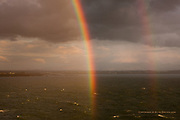Caught in a rainstorm on an exposed headland. The silver lining was a pot of gold beneath the multi-coloured rainbow