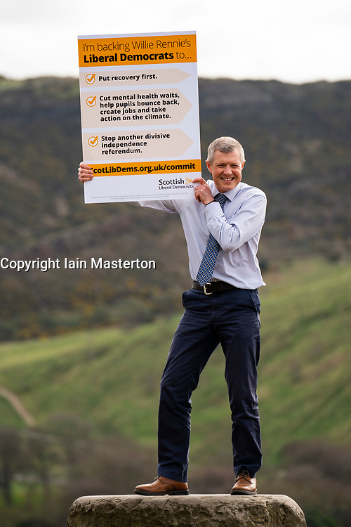 Edinburgh, Scotland, UK. 30 March 2021.Scottish Liberal Democrat Leader Willie Rennie unveils his Put Recovery First commitment card on Calton Hill in Edinburgh ahead of the first TV debate this evening ahead of Scottish elections  Iain Masterton/Alamy Live News
