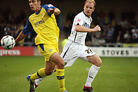 Photo: Rich Eaton.<br /> <br /> Torquay United v Norwich City. Carling Cup. 23/08/2006. Gary Doherty (left) of Norwich and Chris McPhee