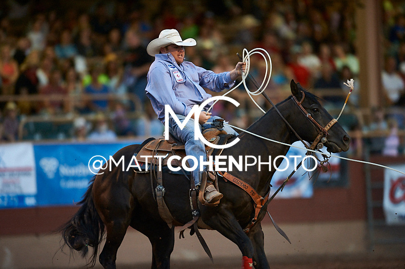 Team roper Lance Fillmore of Pueblo, CO competes at the Pikes Peak or Bust Rodeo in Colorado Springs, CO.<br /> <br /> <br /> UNEDITED LOW-RES PREVIEW<br /> <br /> <br /> File shown may be an unedited low resolution version used as a proof only. All prints are 100% guaranteed for quality. Sizes 8x10+ come with a version for personal social media. I am currently not selling downloads for commercial/brand use.