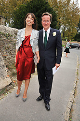 DAVID & SAMANTHA CAMERON at the wedding of Lohralee Stutz and the Hon.William Astor at St.Augustine's Church, East Hendred, Oxfordshire on 5th September 2009.