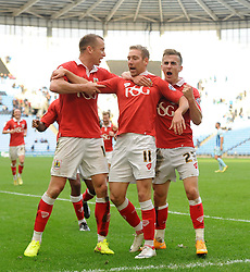 Bristol City's Scott Wagstaff celebrates his goal with Bristol City's Aaron Wilbraham and Bristol City's Joe Bryan  - Photo mandatory by-line: Joe Meredith/JMP - Mobile: 07966 386802 - 18/10/2014 - SPORT - Football - Coventry - Ricoh Arena - Bristol City v Coventry City - Sky Bet League One