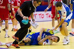 Uros Zorman of Slovenia injured during handball match between Norway and Slovenia in Preliminary Round of 10th EHF European Handball Championship Serbia 2012, on January 16, 2012 in Millennium Center, Vrsac, Serbia. Norway defeated Slovenia 29-28. (Photo By Vid Ponikvar / Sportida.com)