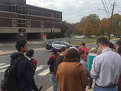 November 1, 2018 - New Britain, CT, USA - Parents wait outside New Britain High School Thursday following rumors of a threat, spread through social media, that ultimately resulted in a two-hour lockdown. Police and school administrators determined there was no danger, however. (Credit Image: © Don Stacom/Hartford Courant/TNS via ZUMA Wire)