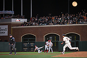 San Francisco Giants shortstop Brandon Crawford (35) runs to second base as Cincinnati Reds second baseman Scooter Gennett (4) makes a wild throw at AT&T Park in San Francisco, California, on May 11, 2017. (Stan Olszewski/Special to S.F. Examiner)