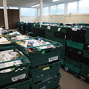 Workers and volunteers at Hackney Foodbank receive and organize food donations, 15th of December 2021, Hackney, East London, United Kingdom. Donated food ready to be distributed across Hackney. The Hackney Foodbank is part of a nationwide network of foodbanks, supported by The Trussell Trust, working to combat poverty and hunger across the UK. The food bank gives out three days emergency food supplies to families and individual who go hungry in the borrough. The food is all donated by individuals and the food donated is held in a small ware house where it is  sorted and packed for distribution.  More people than ever in Britain have turned to the food bank for help and in Hackney the need has gone up with 350% over the past two years.