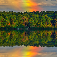 Rainbow across Cochituate Lake and State Park in Middlesex County Massachusetts illuminated by the end of day light.<br /> <br /> Cochituate Lake Rainbow photography images are available as museum quality photography prints, canvas prints, acrylic prints, wood prints or metal prints. Fine art prints may be framed and matted to the individual liking and interior design decorating needs.<br /> <br /> Good light and happy photo making!<br /> <br /> My best,<br /> <br /> Juergen
