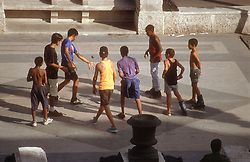 Group of teenage youths playing with ball on the Paseo Jose Marti  was Paseo del Prado  in Havana; Cuba,