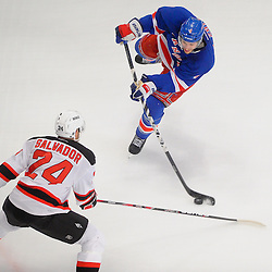 May 14, 2012: New York Rangers defenseman Michael Del Zotto (4) fires a shot past New Jersey Devils defenseman Bryce Salvador (24) during first period action in game 1 of the NHL Eastern Conference Finals between the New Jersey Devils and New York Rangers at Madison Square Garden in New York, N.Y.