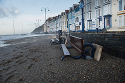 © Licensed to London News Pictures.  Aberystwyth02/02/2014. At first light the damage caused by the overnight storms is apparent on Aberystwyth promenade. Much of the promenade is littered with debris and covered in sand following the storm weather  of the previous night, when Police and coastguards had closed off the seafront to all users as a safety precaution.  Photo credit : Keith Morris/LNP