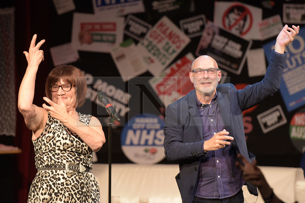© Licensed to London News Pictures. 26/04/2016. Manchester, UK.  Actress and Comedian, Barbara Nice, and Musician, Brian Eno dancing at Saturday Night Live Manchester chat show event as part of the Take Back Manchester festival to protest the Conservative Party conference taking part in the city.  Photo credit: Steven Speed/LNP