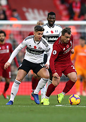 Fulham's Tom Cairney (left) and Liverpool's Xherdan Shaqiri battle for the ball during the Premier League match at Anfield, Liverpool.