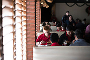 The Iraan High School football team stops for lunch in San Angelo, Texas on December 14, 2016. (Cooper Neill for The New York Times)