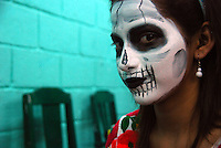 """MEXICO, Veracruz, Tantoyuca, Oct 27- Nov 4, 2009. Dancers prepare to perform at the Preparatorio Benito Juarez in Tantoyuca. """"Xantolo,"""" the Nahuatl word for """"Santos,"""" or holy, marks a week-long period during which the whole Huasteca region of northern Veracruz state prepares for """"Dia de los Muertos,"""" the Day of the Dead. For children on the nights of October 31st and adults on November 1st, there is costumed dancing in the streets, and a carnival atmosphere, while Mexican families also honor the yearly return of the souls of their relatives at home and in the graveyards, with flower-bedecked altars and the foods their loved ones preferred in life. Photographs for HOY by Jay Dunn."""