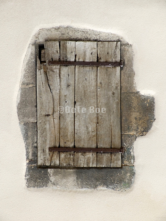 old weathered shutter in wall