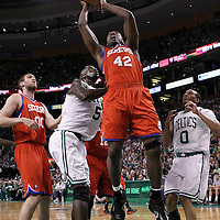 12 May 2012: Philadelphia Sixers power forward Elton Brand (42) grabs the offensive rebound over Boston Celtics power forward Kevin Garnett (5) and Boston Celtics shooting guard Avery Bradley (0) during the Boston Celtics 92-91 victory over the Philadelphia Sixers, in Game 1 of the Eastern Conference semifinals playoff series, at the TD Banknorth Garden, Boston, Massachusetts, USA.