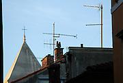Rooftops, crosses and television aerials. Zadar, Croatia
