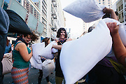 People participate in Feathers of Fury 5:  a Valentine's weekend pillow fight, on Sunday, Feb. 15 outside Camera 12 theater in downtown San Jose.