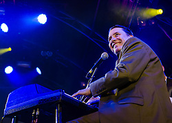 © Licensed to London News Pictures. 22/07/2012. London, UK.  Jools Holland and his Rhythm & Blues Orchestra performs live for BT's River of Music at the Europe stage, Somerset House.  In this pic - Jools Holland.  Photo credit : Richard Isaac/LNP