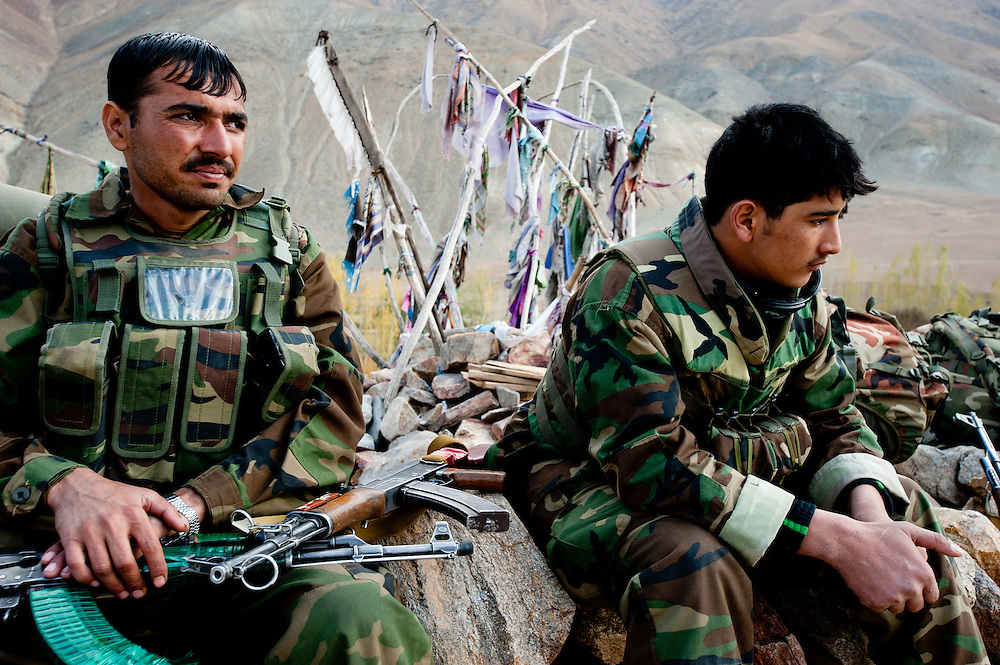 Afghan National Army soldiers rest after an engagement with Afghan insurgents.