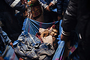 Mineros ayudan a un compañero para que reciba primeros auxilios en una pequeña clínica en Rinconada. El minero fue encontrado inconsciente fuera de un socavón, los médicos al no poder brindarle una buena atención debido a su condición de salud, sugieren llevarlo a Juliaca, una ciudad más grande en un viaje de cinco horas para recibir una mejor atención médica.<br /> <br /> A miner is helped by other miners to receive first aids in a small clinic in Rinconada. He was found unconscious outside of a tunnel, the doctors unable to give him better care due to his delicate health condition, they suggest carry him to Juliaca, a biggest city, a five hours journey, to receive better medical care.