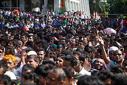 October 13, 2017 - Dhaka, Bangladesh - Bangladeshi people gathered to buy egg for low price during an egg sale fair, to mark the World Egg Day at Dhaka in Bangladesh on October 13, 2017.Previously, the organizers announced that they would sell eggs at a special price of four for Tk12 to celebrate the World Egg Day. (Credit Image: © Mehedi Hasan/NurPhoto via ZUMA Press)