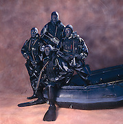 Group Portrait of Navy Seals with night gear and camouflage.