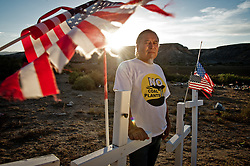 Vernon Lee, standing in front of graves on the reservation, believes that the many people on the Moapa reservation suffering and dying from health issues are because of the coal plant next door. Sierra Club is working with the Moapa Band of Paiutes to transition NV Energy away from the Reid Gardner coal-fired power plant -- which sits only 45 miles from Las Vegas and a short walk from community housing at the Moapa River Indian Reservation. The Reid Gardner coal plant is literally spewing out tons of airborne pollutants such as mercury, nitrous oxide, sulfur dioxide, and greenhouse gases. This has resulted in substantial health impacts on the Moapa community, with a majority of tribal members reporting a sinus or respiratory ailment.
