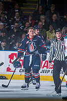 KELOWNA, CANADA - MARCH 24: Nolan Kneen #27 of the Kamloops Blazers skates to the bench as ice officials make penalty calls against the Kelowna Rockets on March 24, 2017 at Prospera Place in Kelowna, British Columbia, Canada.  (Photo by Marissa Baecker/Shoot the Breeze)  *** Local Caption ***