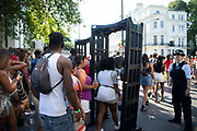Party goers walk though a metal detection point at the Notting Hill Carnival, on 25th August, 2019 in London, United Kingdom. One million people are expected on the streets in scorching temperatures for the Notting Hill Carnival, Europes largest street party and a celebration of Caribbean traditions.
