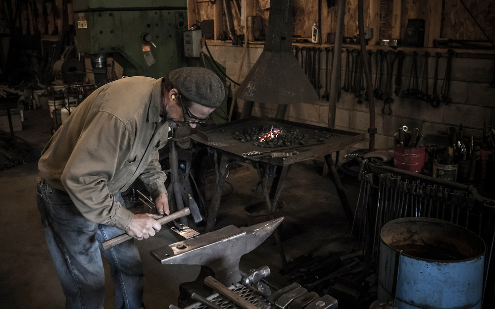 Blacksmith Gordon Gearhart forges belt buckles for competitors in the Marji Gesick 100 endurance event in Marquette County, Michigan.