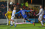 AFC Wimbledon defender Steve Seddon (15) just missing a header during the EFL Sky Bet League 1 match between AFC Wimbledon and Peterborough United at the Cherry Red Records Stadium, Kingston, England on 12 March 2019.