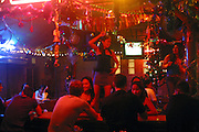 Thai sex workers dance for the tourists in a go-go bar at Chawang beach, Koh Samui, Thailand.