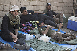 October 23, 2016 - Bartella, Nineveh, Iraq - Iraqi Army  Counter Terrorism soldiers take relax in the Iraqi Town of Bartella...Bartella, a mainly Christian town with a population of around 30,000 people before being taken by the Islamic State in August 2014, was captured two days ago by the Iraqi Army's Counter Terrorism force as part of the ongoing offensive to retake Mosul. Although ISIS militants were pushed back a large amount of improvised explosive devices are still being found in the town's buildings. (Credit Image: © Matt Cetti-Roberts/London News Pictures via ZUMA Wire)