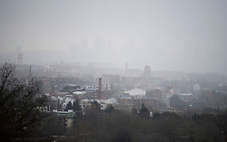 © Licensed to London News Pictures. 24/01/2021. London, UK. Heavy Snowfall shrouds the London skyline as seen fromon Hampstead Heath in Hampstead in north London. Parts of the UK continue to suffer from flooding caused by Storm Christoph. Photo credit: Ben Cawthra/LNP