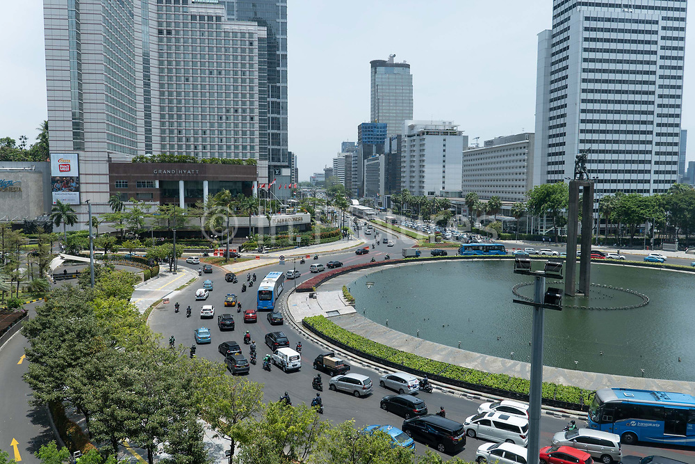 Rush hour in central Jakarta next to the Selamat Datang monument on the 21st October 2019 in Java in Indonesia