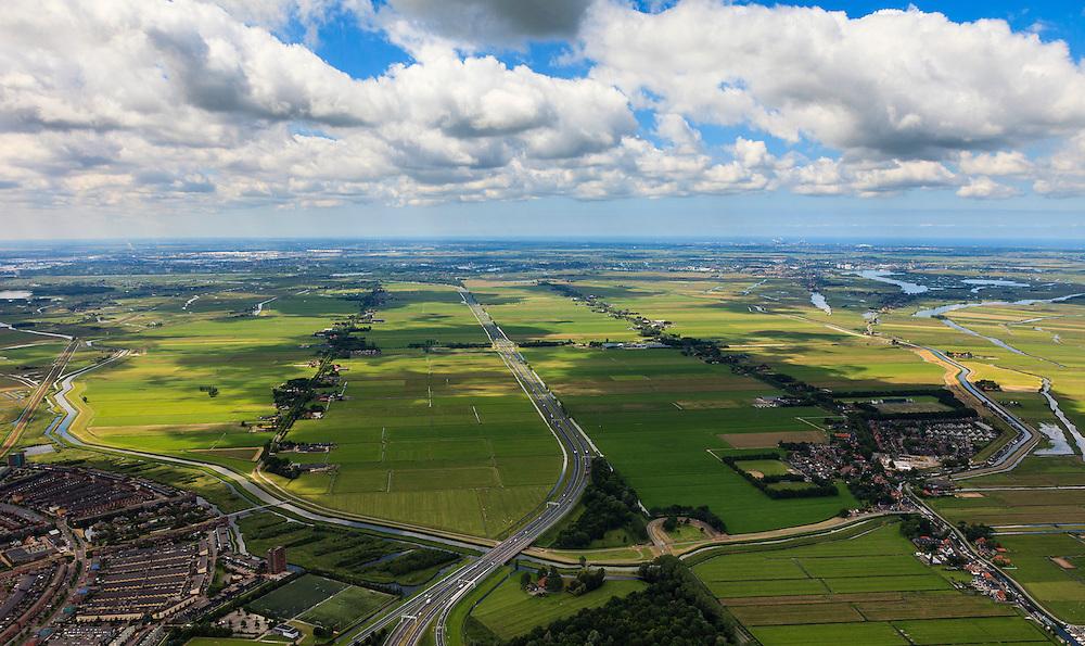 Nederland, Noord-Holland, Gemeente Purmerend, 14-06-2012; polder Wijdewormer, droogmakerij uit de 17e eeuw. Links Purmerend, Vinex wijk Weidevenne, rechts het dorp Neck. Het oorspronkelijke landschap is aangetast door de aanleg van autosnelweg A7..Wijdewormer polder, reclaimed land dating from the 17th century. The original landscape has been affected by the construction of motorway A7..luchtfoto (toeslag), aerial photo (additional fee required);.copyright foto/photo Siebe Swart