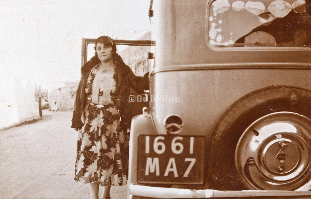 western woman posing with car by the side of the road Morocco 1930s