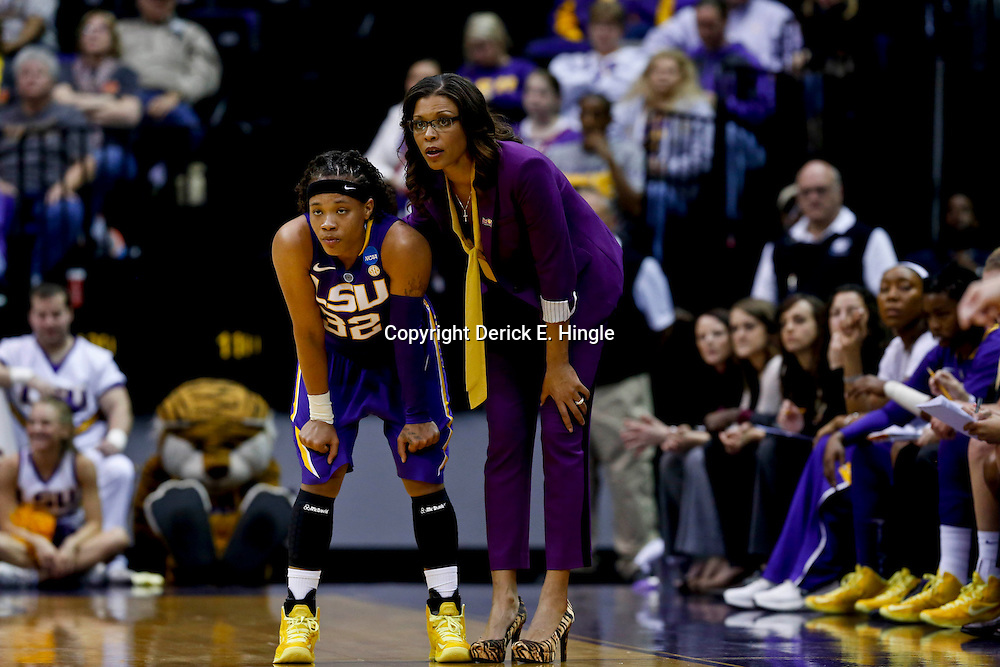 Mar 26, 2013; Baton Rouge, LA, USA; LSU Tigers head coach Nikki Caldwell and guard Danielle Ballard (32) in the first half against the Penn State Lady Lions during the second round of the 2013 NCAA womens basketball tournament at Pete Maravich Assembly Center. Mandatory Credit: Derick E. Hingle-USA TODAY Sports
