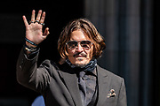 American actor and Hollywood Star Johnny Depp Gestures and Waves to the media and his supporters as he arrives at the Royal Courts of Justice in Central London, on Wednesday, July 22, 2020.  (VXP Photo/ Vudi Xhymshiti)