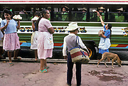 Village women sell food and drinks to passengers passing through on long distance buses that connect San Salvador with the remotest villages of El Salvador.