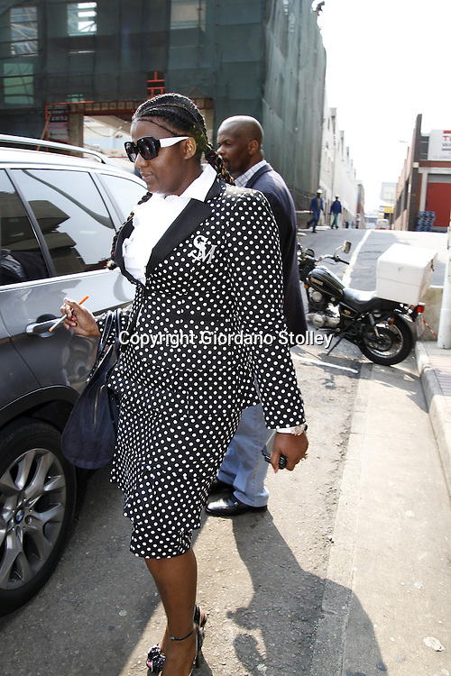 DURBAN - 13 September 2013 - Durban businesswoman Shawn Mpisane leaves the Durban Commercial Crimes Court where she faces 53 charges of fraud, forgery and uttering of a forged document. She is accused of is accused of submitting forged documents to obtain Construction Industry Development Board gradings, which were then used to win five public works department tenders worth R140 million. Picture: Allied Picture Press/APP