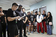 """Fighters pre-fight briefing backstage. Irina Mazepa, 5X Wushu World Champion dressed in white<br /><br />MMA. Mixed Martial Arts """"Tigers of Asia"""" cage fighting competition. Top professional male and female fighters from across Asia, Russia, Australia, Malaysia, Japan and the Philippines come together to fight. This tournament takes place in front of a ten thousand strong crowd of supporters in Pelaing Stadium. Kuala Lumpur, Malaysia. October 2015"""