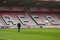 Football - 2017 / 2018 Premier League - AFC Bournemouth vs. Stoke<br /> <br /> Stoke City Manager Paul Lambert cuts a lone figure in the rain on the pitch before kick off at Dean Court (Vitality Stadium) Bournemouth <br /> <br /> COLORSPORT/SHAUN BOGGUST