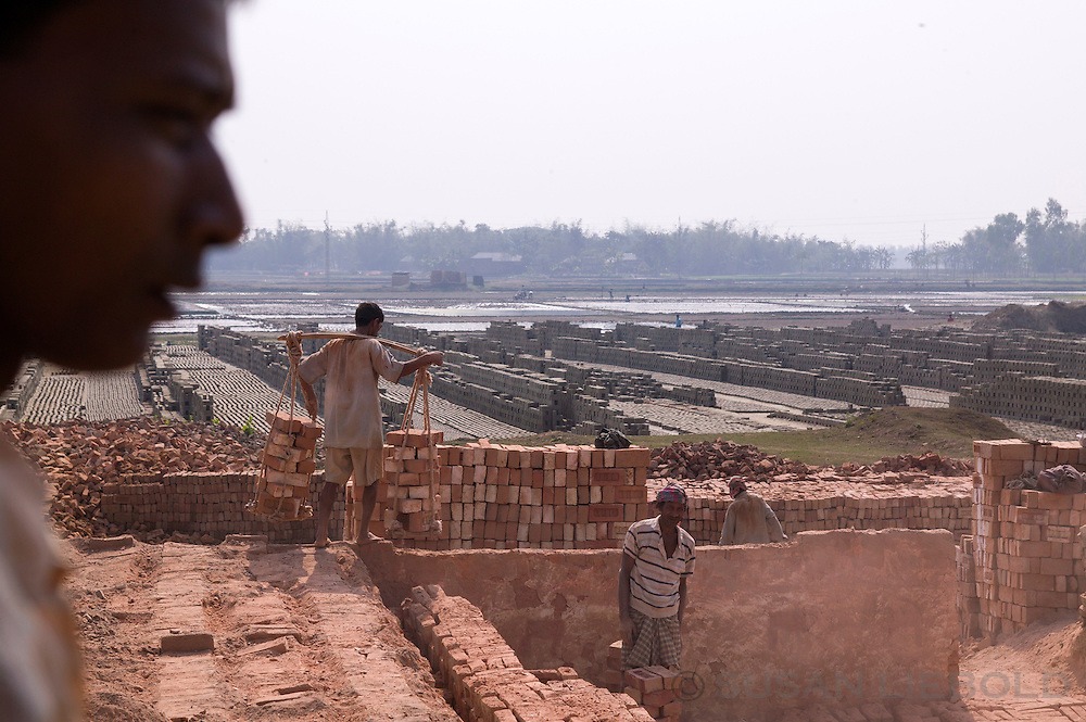 Men working at a brick making factory in Bangladesh.