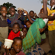 During the evening before Islamic New Year, Koumbadiouma's children go from compound to compound, receiving sweet treats. Invariably, they end up on a sugar high! Kolda, Senegal.