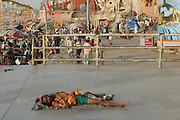 A pilgrim sleeping near the Dashashwamedh Ghat, Varansi, India.