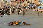 A pilgrim sleeping near the Dashashwamedh Ghat, Varansi, India.